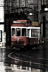 Lisboa(2) (TRUDI.) Tags: street city winter red urban streets reflection portugal colors rain rouge grey reflex nikon cityscape grigio colours rainyday emotion lisboa hiver dream streetphotography tram sigma desaturated inverno rosso trudi colori lisbona portogallo 70300 hotcolors urbanpoetry desaturato urbanarte nikond3000 thephotographyblog trudiphotography