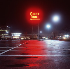 (Josh Sinn) Tags: longexposure color 120 film wet sign night mediumformat dark md neon fuji parking tripod lot maryland slide rainy late arrow laurel provia e6 howardcounty 100f yashicamat124g cablerelease hoco giantfoo joshsinn