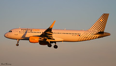 Vueling A320-200 EC-LVU (birrlad) Tags: barcelona morning sunlight sunrise airplane airport aircraft aviation airplanes bcn finals airline airbus arrival airways approach airlines runway airliner a320 arriving vueling a320200 a320214 25r sharklets eclvu