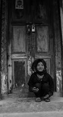 Kid at the door (Matteo Vanerio) Tags: life door travel nepal portrait people blackandwhite bw white black monochrome smile portraits children happy kid asia child viaggio nepali