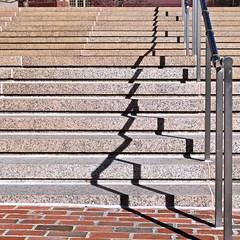Stairs No 4 (llawsonellis) Tags: urban outdoors stairs railing shadows line linear lines patterns bricks concrete steel crop texture rhythms repetition red biege grey black square squareframe texturesquared squarestairs selection abstractselection nikon nikond5300