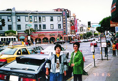 Condor Gentlemen's Club, Big Al's adult bookstore, Roaring 20's strip club and Lee Poy Watch Repair and Gift - My aunt(y) Sarah and I were both in the Red Light District (560 Broadway and Columbus Avenue) - fixed (kalihikahuna74 (OkinawaKhan808)) Tags: san francisco sanfrancisco fixed image trip vacation august 1997 bayarea thebay 1990s 90s analog predigital camera scanned scan pointandshoot pointandshootcamera oldschool america unitedstates unitedstatesofamerica stateside us