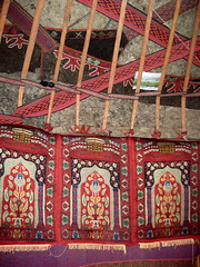 Kyrgyz Yurt Interior Xinjiang Uyghur Autonomous Region China (eriagn) Tags: yurt felt wool pattern traditional portable conical circular weatherproof warm insulated handcrafted kyrgyz karakullake muztaghata chinanationalhighway314 karakoramhighway kkh sanddune river dune mountain snow peak stonebuilding highway road highaltitude scenic landscape remote rugged geology eurasianplate indianplate tectonics sarykol yellowlake gezrivercanyon ghezriver murztaghata ethnic pakistan pamir kunlun silkroad traderoute ngairehart ngairelawson eriagn threadsinthesand expedition travel adventure photography route asia china centralasia farwesternchina cold kongershan shyrdak shirdak red weaving