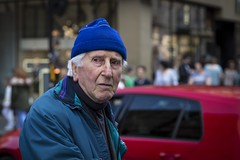 Still Got The Blues (Leanne Boulton) Tags: people urban street candid portrait portraiture streetphotography candidstreetphotography candidportrait streetportrait streetlife blue red colourful old aged elderly man male face facial expression eyes skin tone texture detail depthoffield bokeh naturallight outdoor light shade shadow city scene human life living humanity society culture canon canon5d 5dmarkiii 70mm character ef2470mmf28liiusm color colour glasgow scotland uk