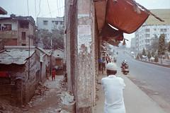 Duality (Sheikh Shahriar Ahmed) Tags: dhakadivision dhaka bangladesh tejgaon nakhalpara elevated road street streetlife development project film kodakcolorplus200 olympusmjuii pacificimage primefilm3650pro3 sheikhshahriarahmed