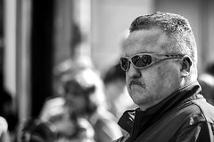 Looking glum (Frank Fullard) Tags: frankfullard fullard candid street portrait glum serious shades monochrome blackandwhite parade moustache mayo irish ireland castlebar