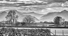 misty distance (scottprice16) Tags: england cumbria lakedistrict view landscape hills fells mountains north west keswick wall drystone trees spring march mist cloud storms blackwhite monochrome fujixt1 18135mm