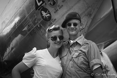 WWII re-enactors by B-17 bomber (calkothrade2) Tags: b17bomber warbirrd wwii eighth airforce aviation chrome blue sky clouds propeller guns cannons yankee lady reenactment young couple