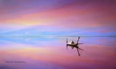 becoming one (Ifigeneia Vasileiadis) Tags: sky reflection boat sunset vibrant brilliant tones nikond7200 lake spring messolonghi