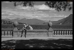 «Taking care» (Paolo Bosetti) Tags: bw dog drinking lake man thirsty water