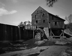 Yates Mill 2  (Pinhole 4x5) (F. Neil S.) Tags: pinhole largeformat 4x5 sheet film ilfordfp4 xtol selfdev harman titan blackandwhite timeexposure dam waterfall waterwheel mill historic sunny springday piedmont clapboard
