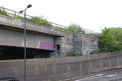 Window in the Bridge (doojohn701) Tags: concrete a2 road bridge window 1960s vegetation uk eltham london lamposts graffiti