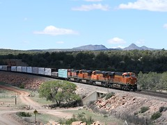 The H-BARTEA1-28 led by BNSF ES44C4 8089 peaks out from under the clouds as it passes Goldtrap tank on the transcon north of Ash Fork, Az (DTR CEO) Tags: arizona ge es44c4 freight manifest bnsf locomotive transcon ashfork action scenic