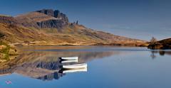 Peaceful Morning at Loch Fada (Dave Massey Photography) Tags: lochfada oldmanofstorr isleofskye cliffs mountains reflection boats scotland