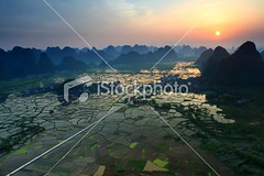 Rice-fields-at-sunset-yangshuo-guilin-china (MPBHAIBO) Tags: china road cloud mist mountain reflection water fog sunrise landscape dawn spring highway shiny asia village guilin yangshuo hill aerialview growth crop backlit  sunbeam cloudscape ricepaddy stormcloud scenics mountainrange  traditionalarchitecture chineseculture vibrantcolor brightlylit    urbanscene  mountainpeak ruralscene   karstformation chineseethnicity  guangxiregion