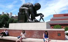 The British Library, ' Newton '. (davidezartz) Tags: leica uk greatbritain blue trees light red england sky people sculpture brown sunlight white black green london monument yellow statue bronze clouds buildings grey shadows library bricks scottish courtyard british cal