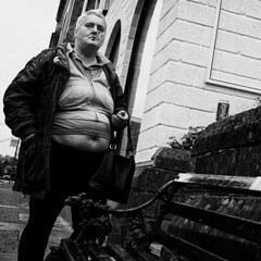 Elegant (Ross Magrath) Tags: from street camera uk portrait england bw woman white black west colour face lady contrast digital wonderful dark photography mono weird high funny noir shadows gloomy serious pentax no candid character north streetphotography sunny smoking v shade angry unknown shooting cropped format imaging gloom gr hip agus ban drama miserable et blanc ricoh sneaky compact sensor informal englang dubh apsc rossmagrath