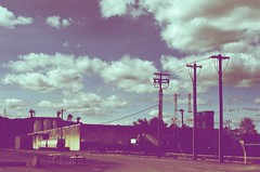 (rozuhlee) Tags: color film skyline train 35mm portland xpro powerlines crossprocessing freight exploregon