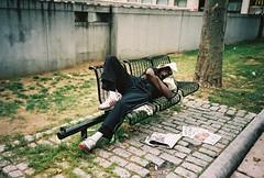 mayowa adelugba (Mayowa Adelugba) Tags: street man film 35mm bench photography photo haiti dominican republic sleep newspapers photographers buy megapixels mayowa tumblr lensblr adelugba