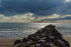 La jetée de rochers (jeanmichelchuiche) Tags: sea mer france clouds hiver nuages viasplage vias enrochements hérault épi