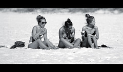Beach Snacks (Poocher7) Tags: blackandwhite monochrome people candid portrait beach sand southbeach towels friends snacking eating tiedhair updoos sitting bikinis dunegrass purse sandals sunglasses wind florida usa southwestflorida marcoisland