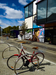 The Red Bike With Basket (Steve Taylor (Photography)) Tags: wongi wilson art graffiti mural streetart architecture bench colourful newzealand nz southisland canterbury christchurch cbd city shadow bike bicycle