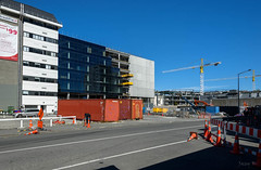 Lots of New Buildings (Jocey K) Tags: newzealand southisland christchurch architecture buildings street road sky rebuild construction cranes shadows raodones signs shippingcontainer cbd