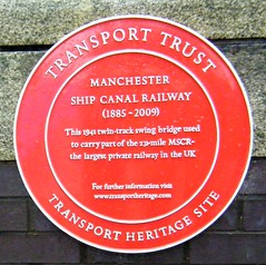 Salford Quays - plaque giving details of bridge (rossendale2016) Tags: salford quays red plaque manchester ship canal describing railway bridge metal aluminium largest private twin track large uk united kingdom twintrack