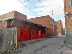 Red (navejo) Tags: montreal quebec canada garage doors alley fence wires