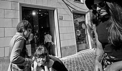 Thank heaven for little girls...... (Baz 120) Tags: candid candidstreet candidportrait candidface candidphotography street streetphoto streetcandid streetphotography streetphotograph streetportrait rome roma romepeople romestreets romecandid europe women monochrome monotone mono blackandwhite bw noiretblanc urban voightlander12mmasph life leicam8 leica primelens portrait people unposed italy italia city girl grittystreetphotography faces decisivemoment strangers