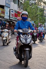 . (Out to Lunch) Tags: motorbike girl scooter yamaha nouvo lx ba chieu market saigon ho chi minh city vietnam face mask