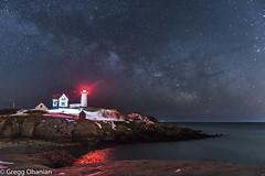 Nubble Light at night (greggohanian) Tags: lighthouse light milkyway stars rocks ocean york maine nubblelight yorkmaine night snow red redlight