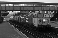 Loco 50 030  |  Guildford UK  |  1982 (keithwilde152) Tags: br class50 guildford surrey uk 1982 station platforms tracks footbridge passenger train city diesel locomotives blackandwhite monochrome outdoor