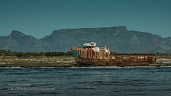 robben island with Table mountain in b/grnd (AndreDiener) Tags: shipwreck island beach scene ocean mountain rust