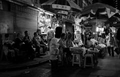 """""""night life"""" (hugo poon - one day in my life) Tags: x100f hongkong wanchai market crossstreet citynight friends fruit stall vanishing streetlife people passingby"""