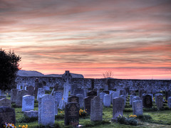 Sunset from St Aidan's Church, Bamburgh (neilalderney123) Tags: ©2017neilhoward olympus landscape graveyard graves church bamburgh northumbria sunset sunsetlight