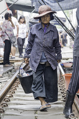 So it has been - a daily routine (dlorenz69) Tags: old woman market maeklong thailand railway shopping vendor portrait age life routine daily