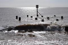 Silvery sea (Kirkleyjohn) Tags: pakefield pakefieldbeach sea seashore waves light silhouettes groyne contrejour glitterpath