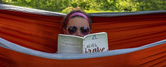 Lets all be brave..... (Kevin Povenz Thanks for the 3,000,000 views) Tags: 2014 august kevinpovenz westmichigan michigan holland hopecollege girl female reading hammock red green sunglasses book relaxing