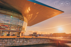 Sunset at the Opera (Adrian Court LRPS) Tags: architecture art aurorahdr blue building canal copenhagen denmark europe glass hdr holmen operahouse orange people reflections roof sunset water københavn capitalregionofdenmark dk nikon d750 1424f28