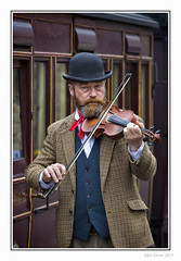 Tanfield Fiddler (Seven_Wishes) Tags: newcastleupontyne tanfield hh photoborder outdoor canoneos5dmarkiv canonef70200f28lisii edwardianeaster heritage railway busker musician violinist violin fiddle music people man beard bowlerhat portrait