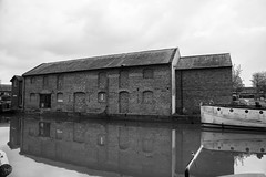 Devizes: Kennet and Avon Canal (thulobaba) Tags: kennetandavon canal navigation victorian waterway tourism tourist leisure wiltshire devizes caenhill england monochrome blackandwhite wharf redbrick bygone industrial reflections