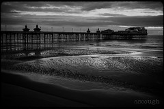 The North Pier in the rain (Jeff Ascough) Tags: leica leicam6 film ilfordxp2 blackandwhite pier beach water sand coast blackpool landscape filmphotography 28summicron summicron 28mm