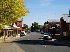 Chiltern. Main Street of this historic gold rush town of 1858. Athenaeum is on the right. (denisbin) Tags: stationstationchilternadvertisingrego self raising flourlakeviewlakeview housemain streetkerosenepennant kerosene chiltern cyclist mainstreet goldtown heritage athenaeum museum
