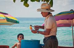 Mexican Boy Buys Ice Cream at Beach (terbeck) Tags: boy beach strand mexico playa icecream eis nio junge mexiko eisverkufer terbeck