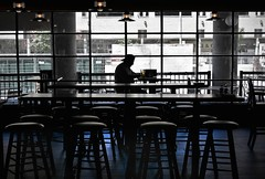 guy in a bar (Mr.  Mark) Tags: blue deleteme5 light shadow deleteme8 toronto man deleteme deleteme2 deleteme3 deleteme4 deleteme6 deleteme9 deleteme7 window beer lines silhouette bar photo chair nikon alone glow afternoon saveme saveme2 saveme3 deleteme10 stock stool markboucher d5200