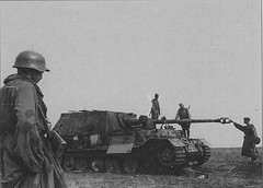 "Panzerjäger Tiger (P) Elefant SD. Kfz. 184. Kursk 1943.<br />Soviet soldiers inspect shot down during the battle of Kursk German heavy self-propelled artillery installation class of tank destroyers ""Ferdinand"" (Ferdinand). Photo also interesting rare for 1943 steel helmet school-36 on the soldier on the left."