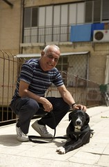 (Caitlin H. Faw) Tags: light shadow portrait dog pet house man color building home smile june shirt canon eos israel hand apartment teeth sneakers nike jaffa 5d leash striped yafo markiii 2013 caitlinfaw caitlinfawphotography