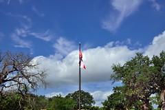A Flagpole of the US and Texas Flags (thor_mark ) Tags: trees texas unitedstates americanflag flags flagpole hillcountry fredericksburg texasflag usflag texasstatepark enchantedrockstatenaturalarea colorefexpro blueskieswithclouds nikond800e