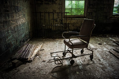 We're all mad here (Erin Watson/Abandoned Exploration) Tags: light urban dusty abandoned window modern canon hospital dark insane crazy chair ruins midwest quiet photographer sad decay seat exploring explorer wheelchair ruin dirty patient dirt memory lonely grime lunatic derelict ue urbex 2013 beautyindecay erinwatson erinwatsonphotography theresalwaysachair